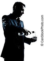 silhouette man portrait pouring white alcohol