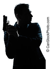 silhouette man portrait with gun - one caucasian spy...