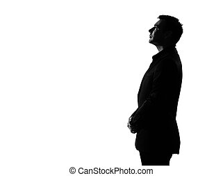 silhouette man profile serious looking up
