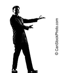 silhouette caucasian business man expressing showing gesture introducing presentationsimiling behavior full length on studio isolated white background