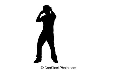 Silhouette man singing into a microphone - A silhouette man...