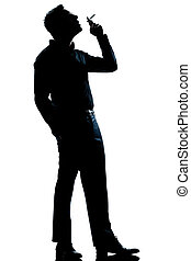 silhouette man smoking cigarette full length