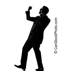 silhouette man winner on the phone
