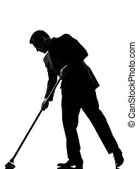 silhouette man wiping brooming - silhouette caucasian...
