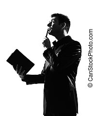 silhouette man with note pad pensive thinking