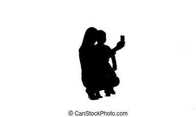 Silhouette Mother And Son Posing For Selfie