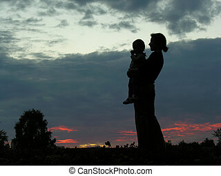 silhouette mother with baby