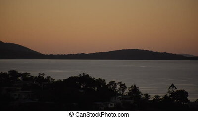 Silhouette mountains surrounding the beach - A scenic pant...