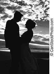 Silhouette newlyweds - Silhouette of newlyweds on beach