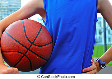 Silhouette of a basketball player outdoor