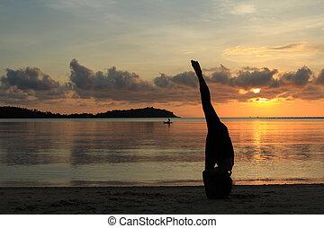 yoga beach split bald woman sitting in split or