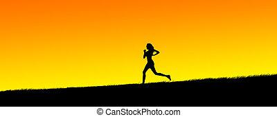 young women jogging - silhouette of a beautiful young women ...