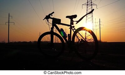 Silhouette of a bicycle at sunset.