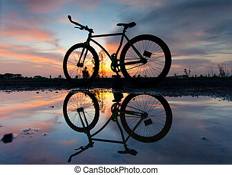 silhouette of a bicycle at sunset