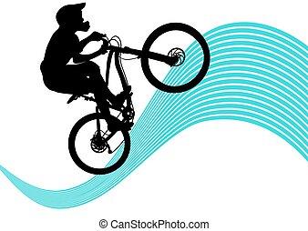 Silhouette of a biker descending on a mountain bike on a...
