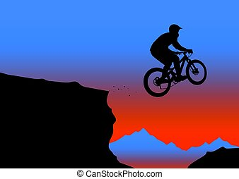 Silhouette of a biker jumping from mountain ledge with...
