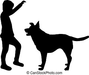 Silhouette of a boy with a dog.