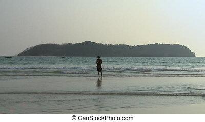 Silhouette of a Burmese Fisherman, Ngapali Beach - Wide, low...