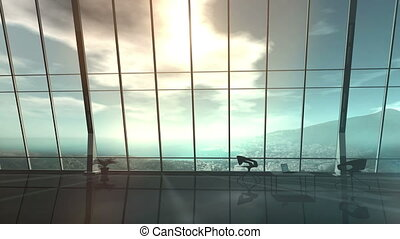 Silhouette of a business woman on the background of an office window.