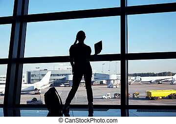 silhouette of a businesswoman at the airport