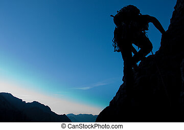 Silhouette of a climber with large copay space