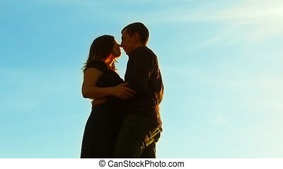 silhouette of a couple at sunset. Man and woman silhouette...