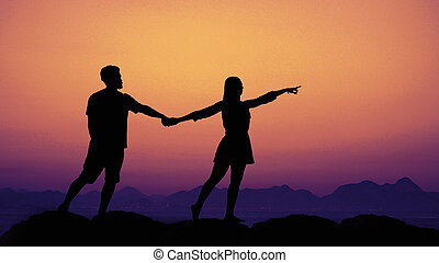 Silhouette of a couple in love at sunset as symbol for wedding