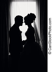 silhouette of a couple in love bride and groom on the wedding
