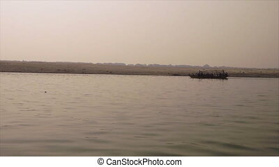 Silhouette of a crowded local boat, Ganges River - Wide...