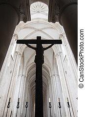 Silhouette of a crucifix in church