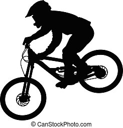 Silhouette of a cyclist going down on a mountain bike on a...