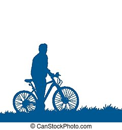 Silhouette of a cyclist on the grass
