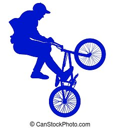Silhouette of a cyclist performing a trick on a bicycle