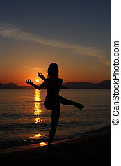 silhouette of a dancer in the beach