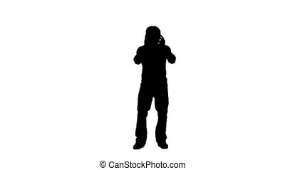 Silhouette of a dancing man listening to music