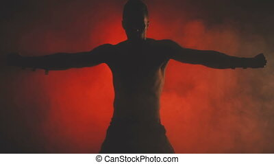 Silhouette of a dancing sexy man