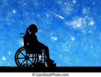 Silhouette of a disabled child girl sitting in a wheelchair looking at the starry sky