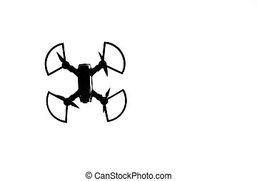 Silhouette of a drone in the sky