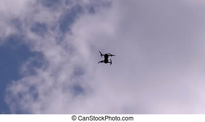 Silhouette of a Drone on a Background of Blue Sky with ...