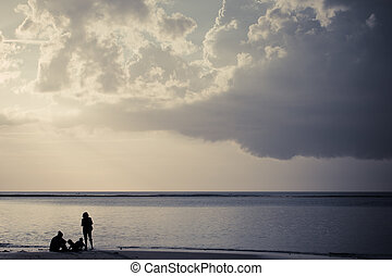 Silhouette of a family on the beach