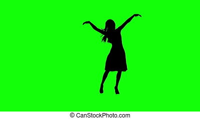 Silhouette of a Girl Dancing on a Green Screeen