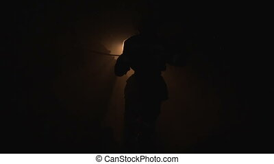 Silhouette of a girl dressed as a miner in a mine