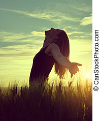 girl in a barley field - Silhouette of a girl in a barley...