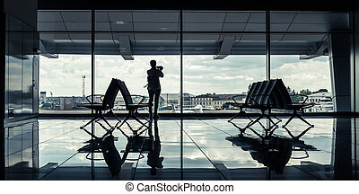 silhouette of a girl in an airport terminal