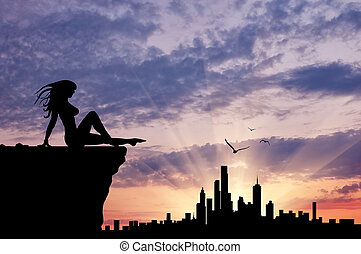 Silhouette of a girl looking at city