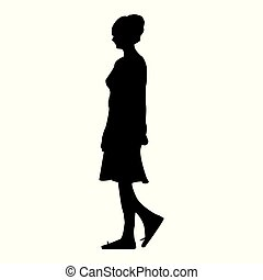 Silhouette of a girl walking through the city