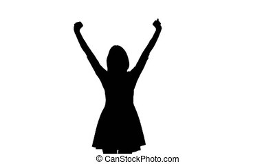 Silhouette of a girl who is dancing happily a white...