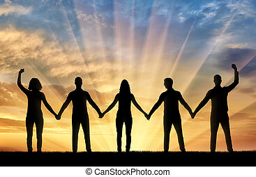Silhouette of a group of happy people of five people holding...