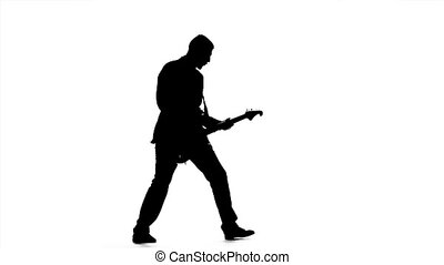 Silhouette of a guitar player. Playing the instrument. Slow motion