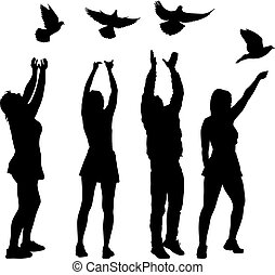 Silhouette of a guy and a girl letting go of the dove into the sky